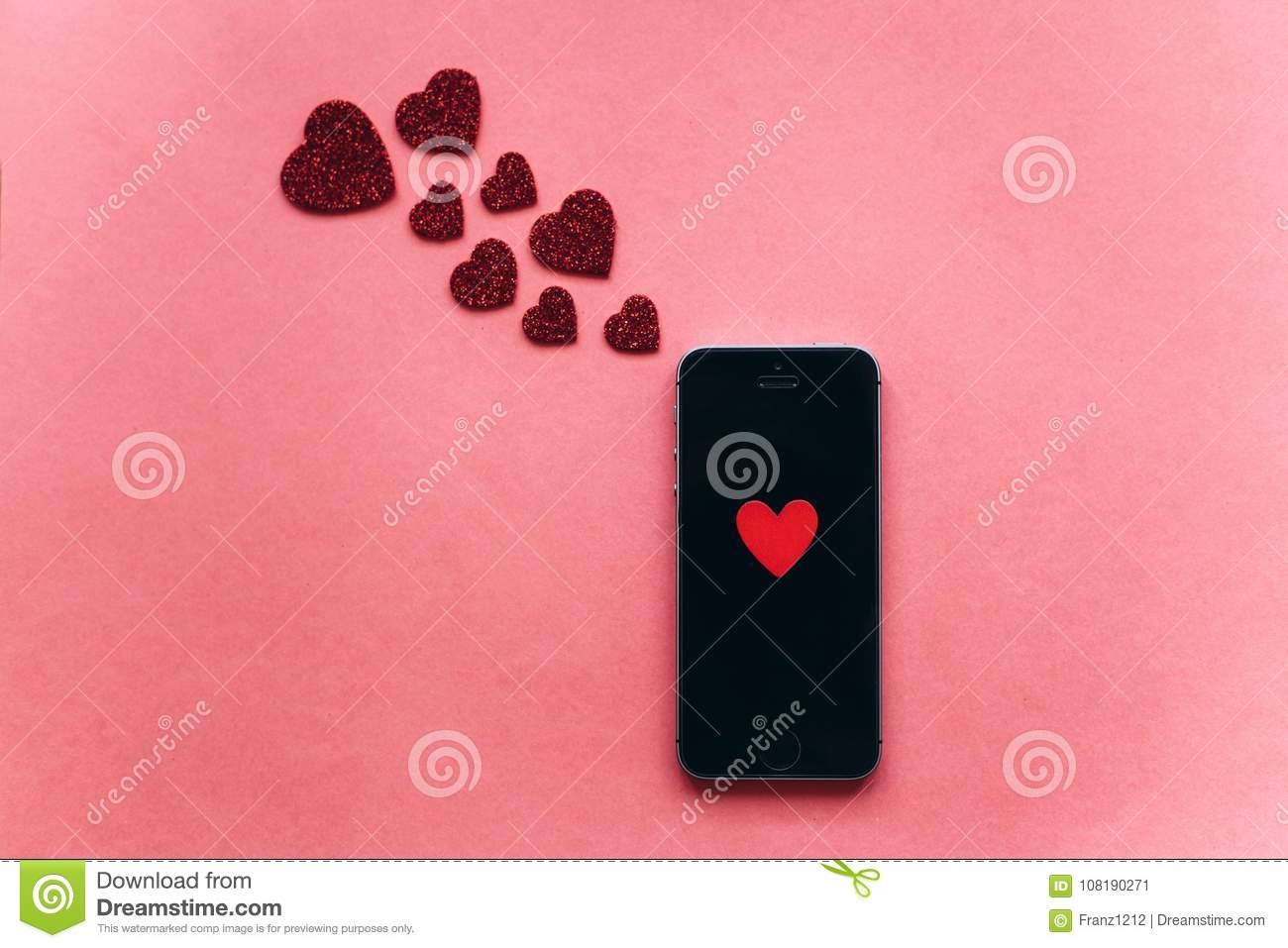 Top View Heart On The Phone Screen Nearby Are Symbols In The Shape
