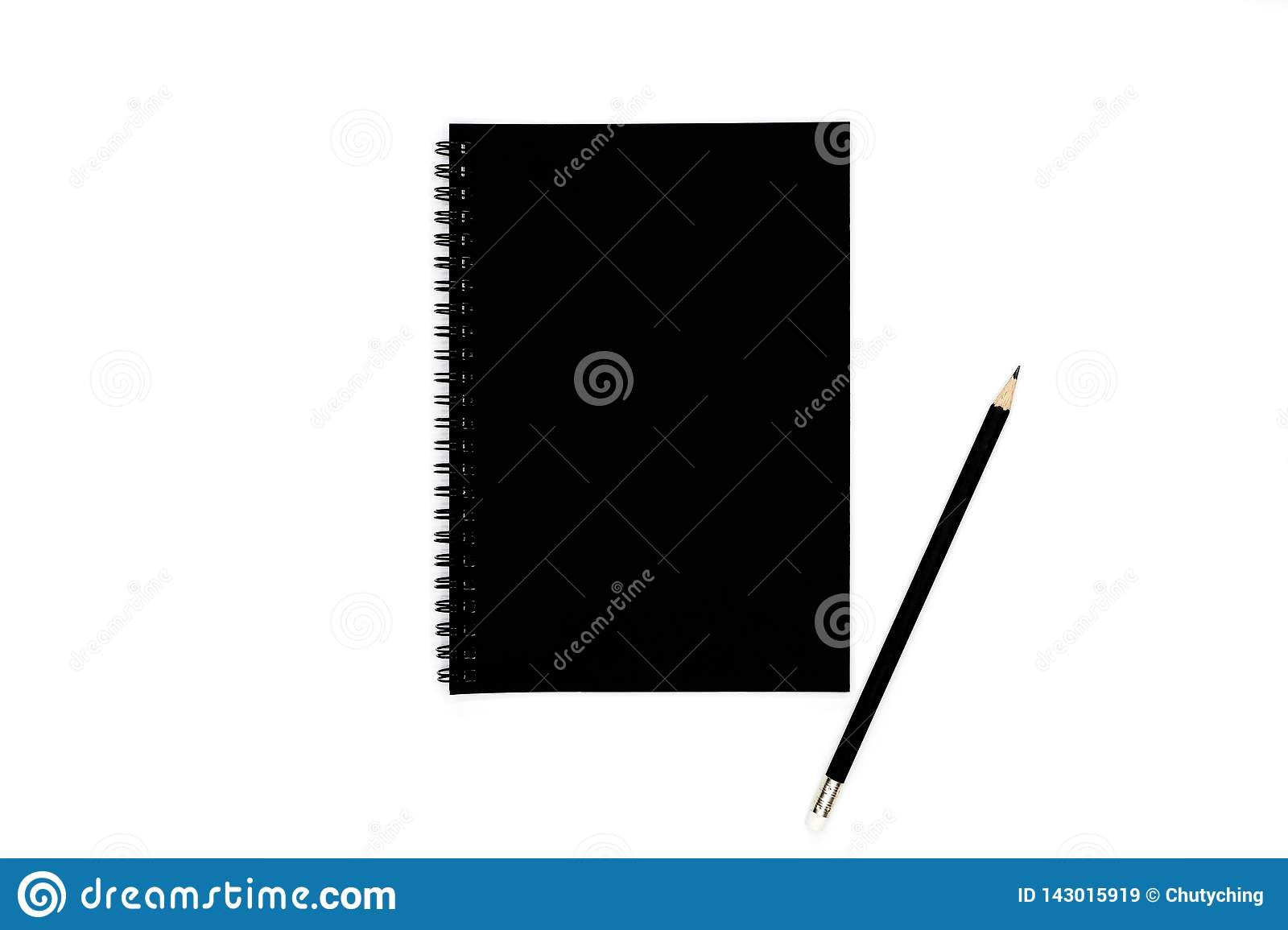 Black spiral notebook with black pencil, isolated on white background.