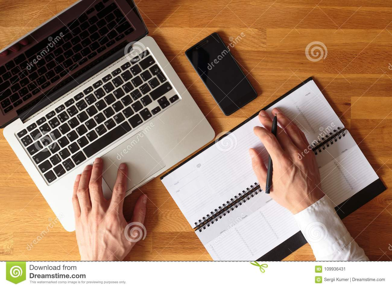 Top view image of business man hands with laptop