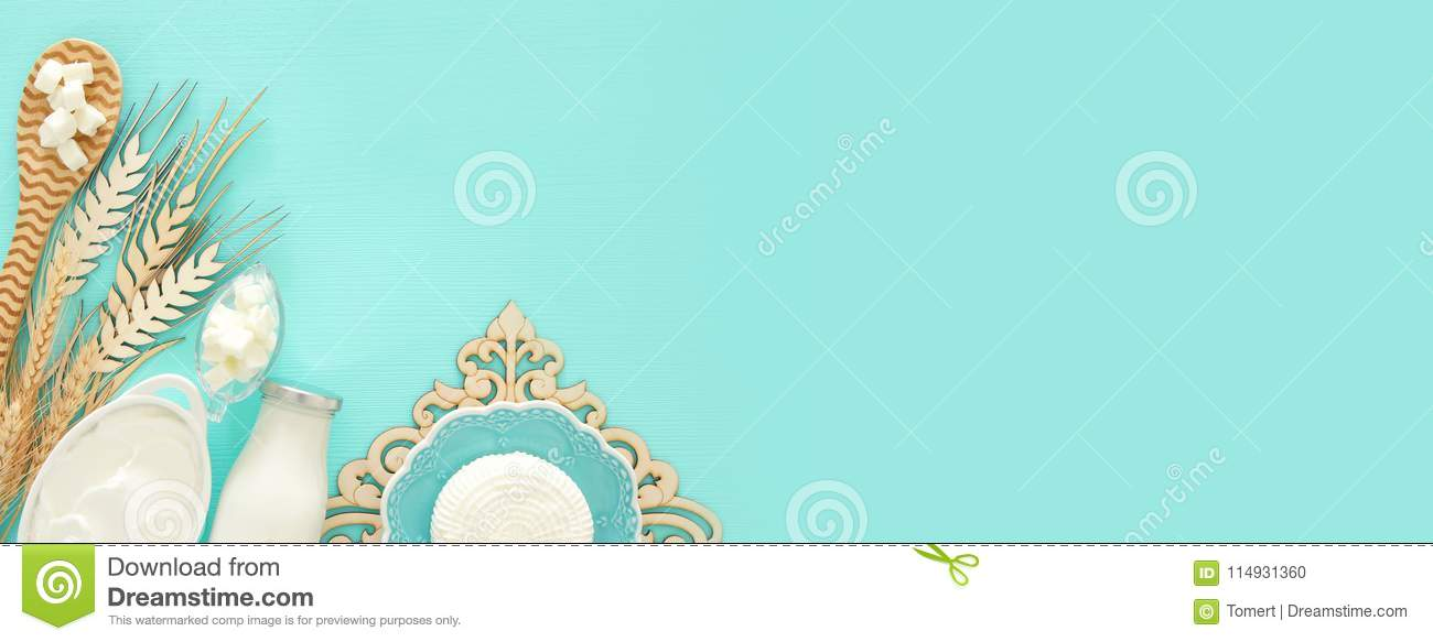 Top View Image Of Dairy Products Over Mint Wooden Background