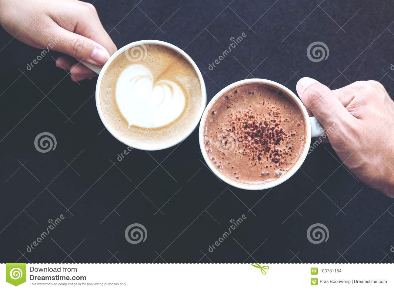 Top view image of man and woman`s hands holding coffee and hot chocolate cups