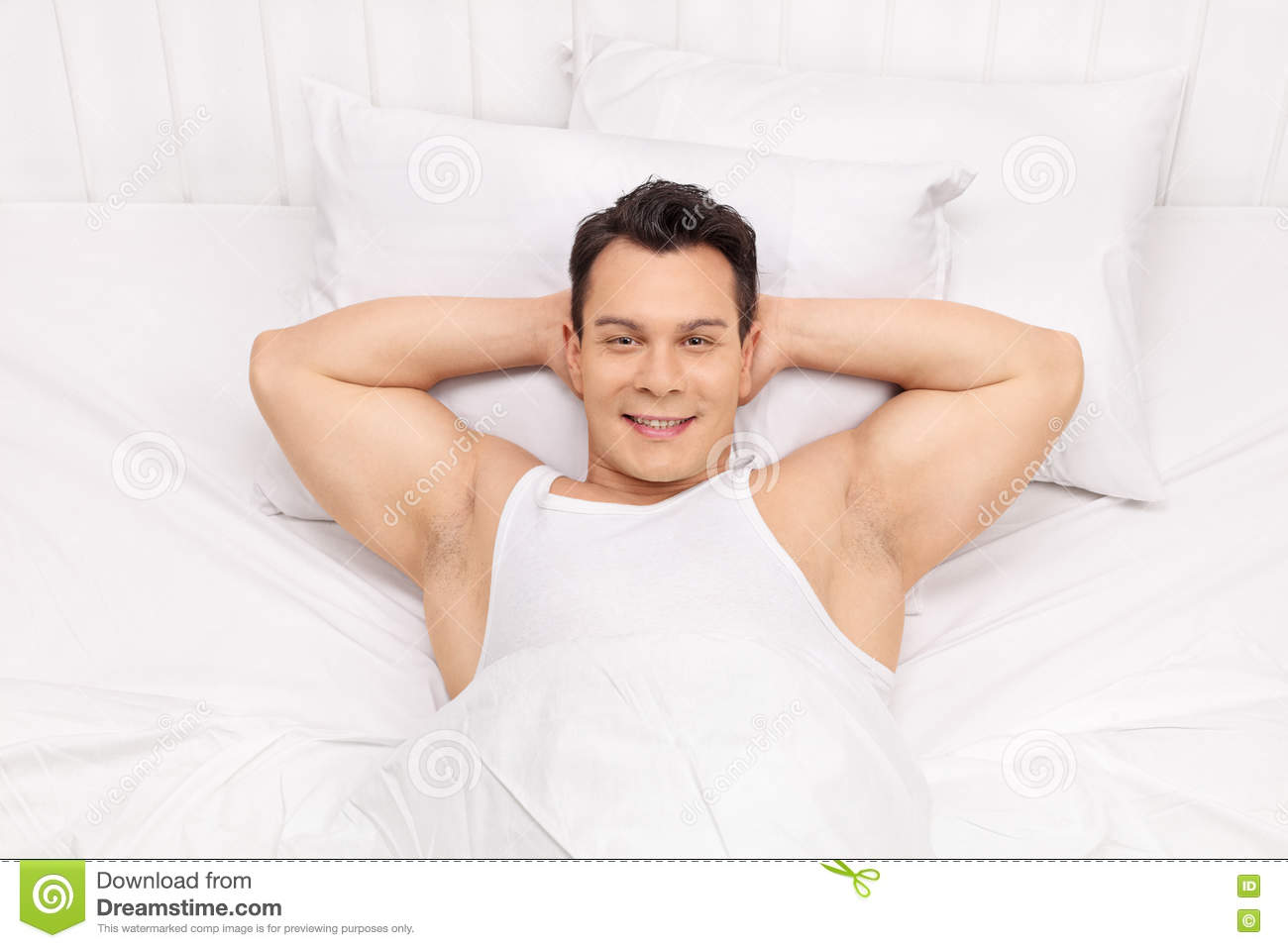 top view of a joyful man laying on bed stock photo - image: 70896734