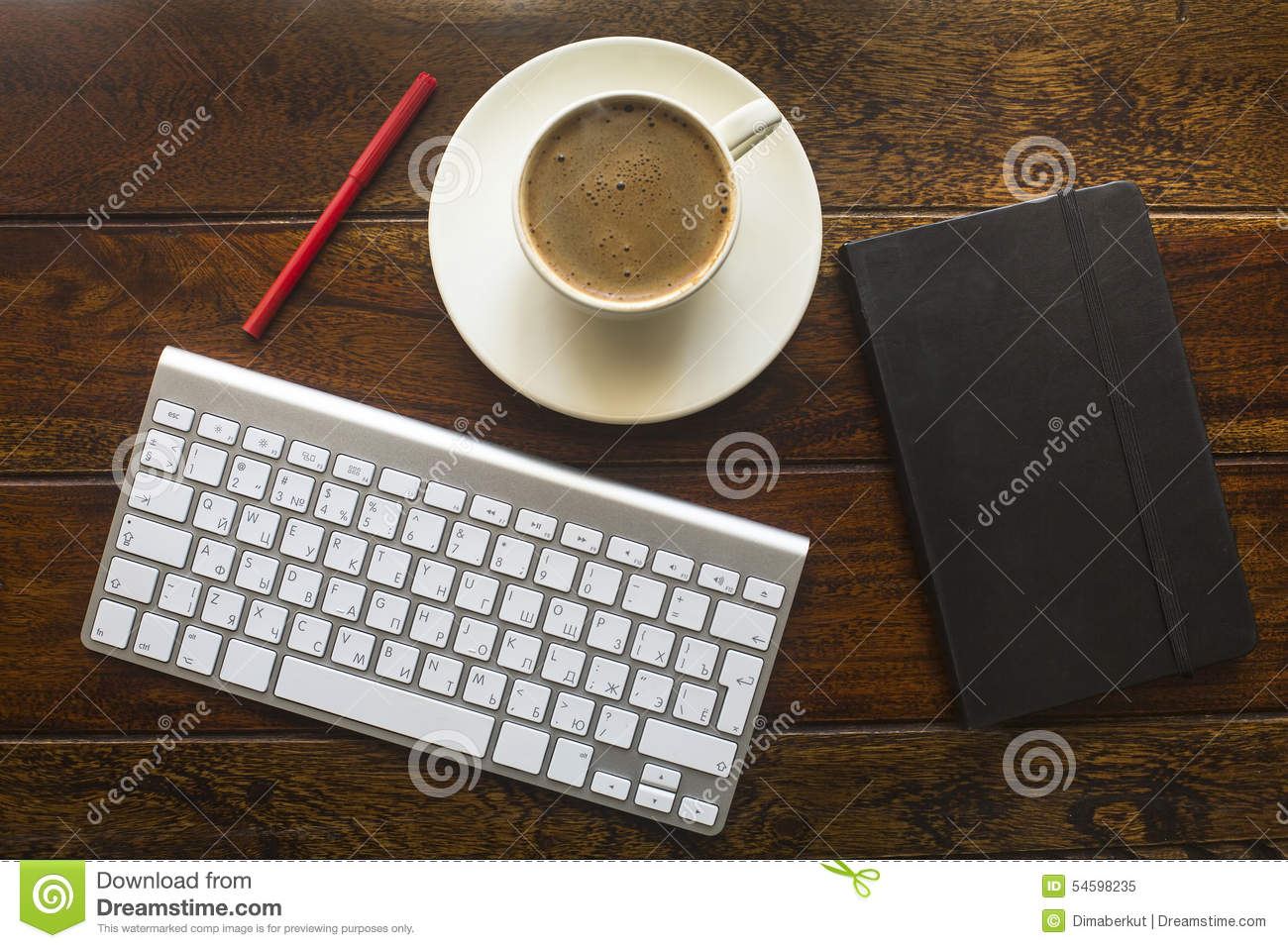 Black coffee cup on old wooden table top view stock photo image top view of keyboard pencil black notebook and a cup of coffee on a geotapseo Gallery