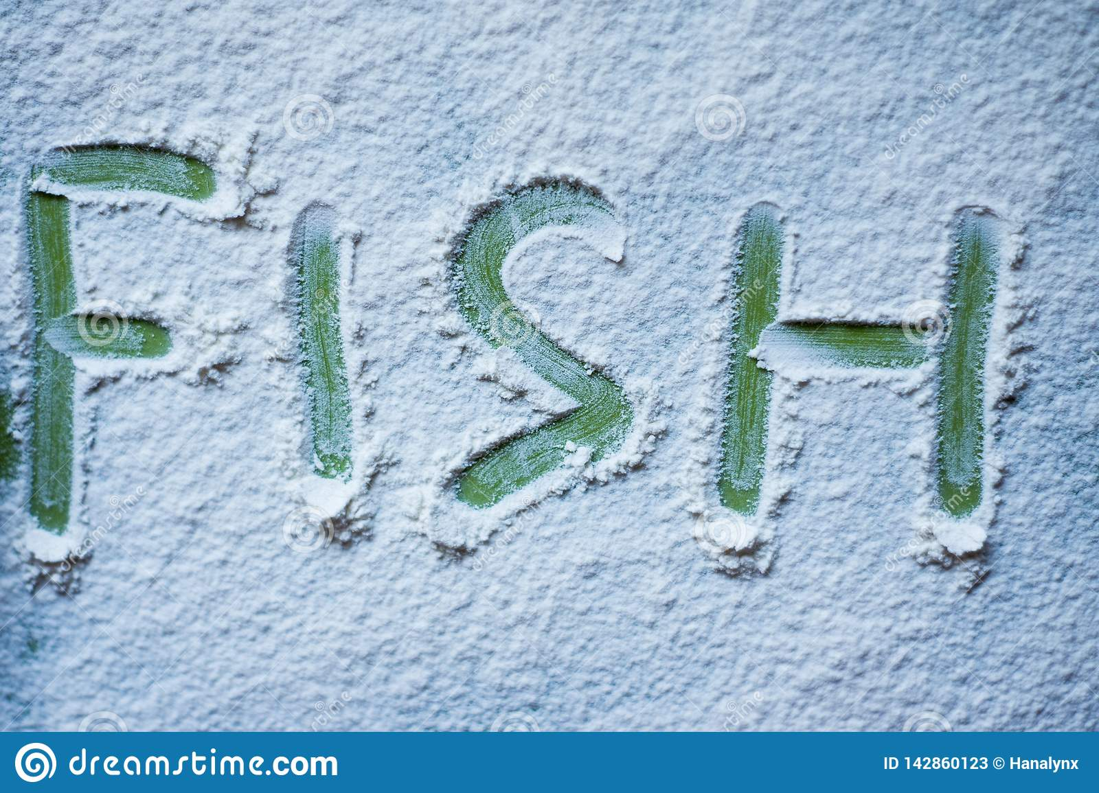 The green word Fish is written in flour
