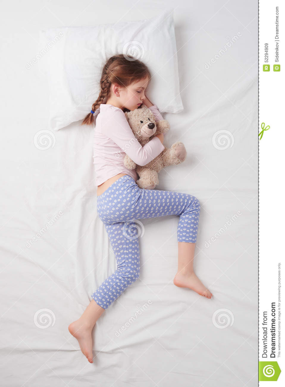 Top View Of Little Cute Girl Sleeping With Teddy Stock