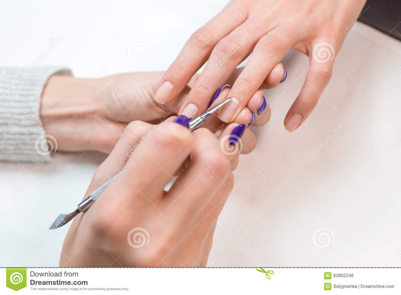 Top View Manicurist Removing Cuticle From The Nail Stock Photo ...