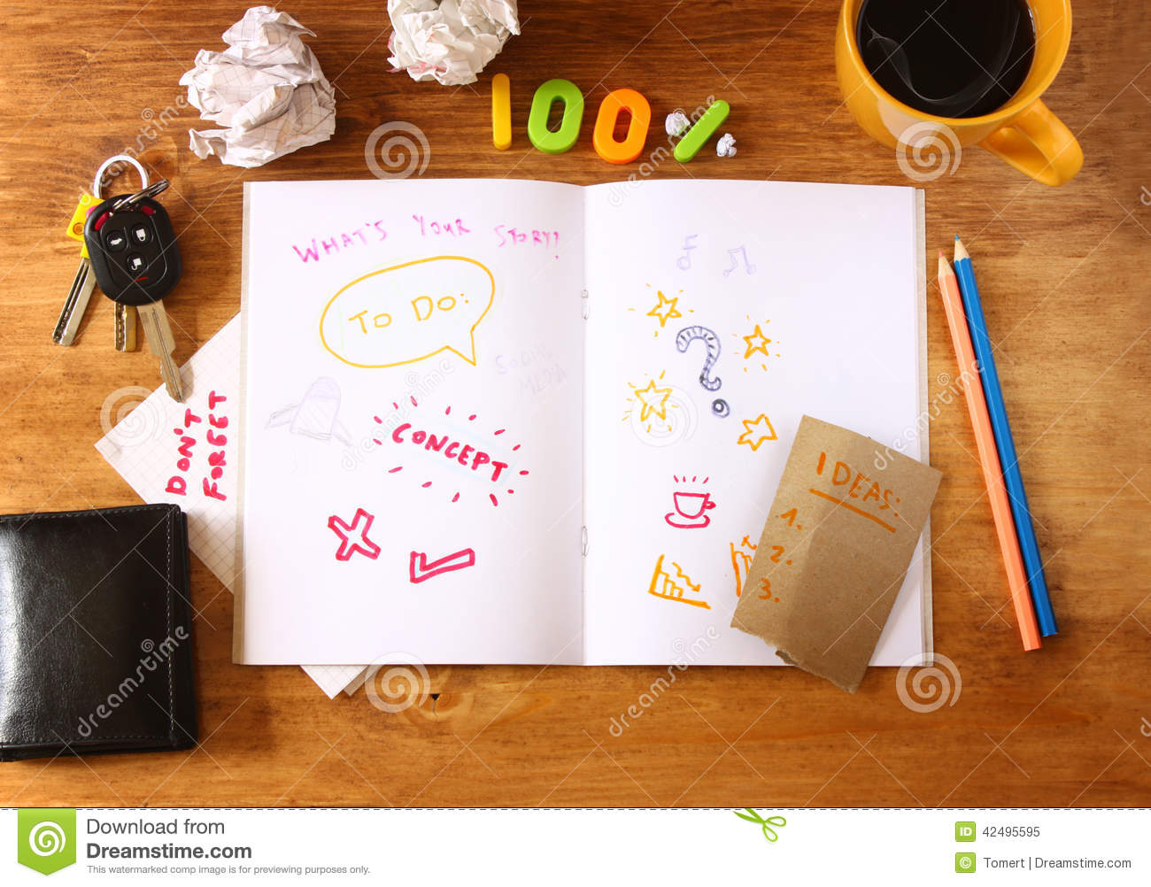 Top View Of Messy Table With Notebook With Doodles Coffee