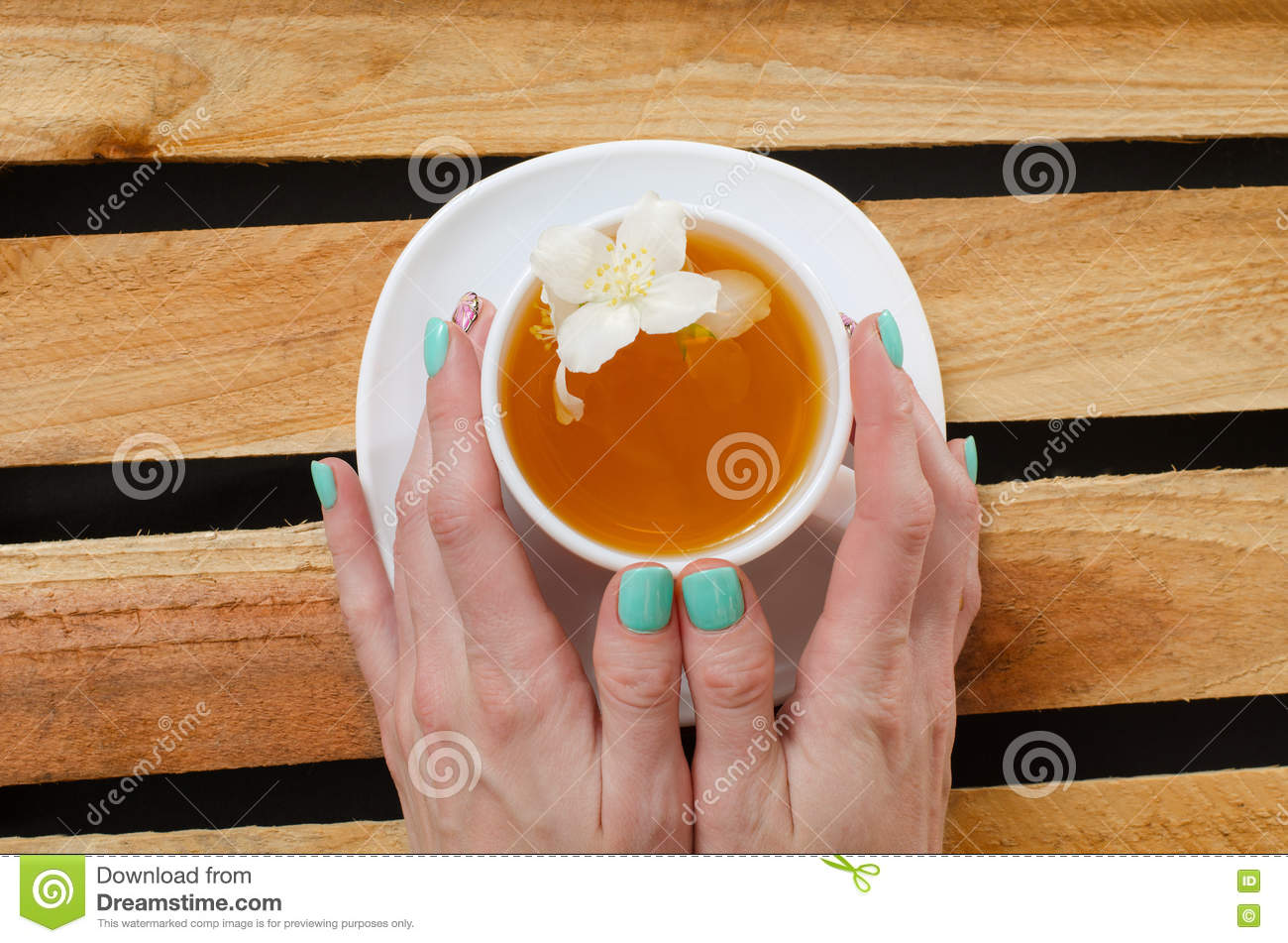 Top view of a mug of herbal tea and jasmine flowers on a wooden top view of a mug of herbal tea and jasmine flowers on a wooden table space for text stock photo image 74423293 dhlflorist Gallery
