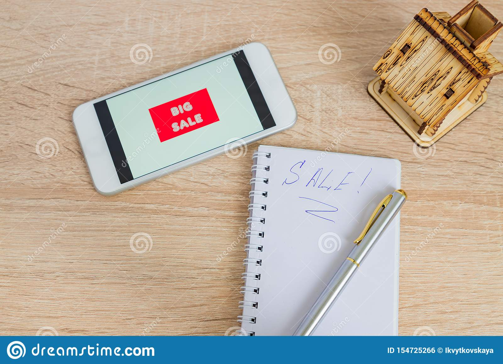 Top View Of Office Desk With White Smartphone With Sale Text Note And Small Wooden House Technology Business Online Shopping And Stock Photo Image Of Commercial Housing 154725266
