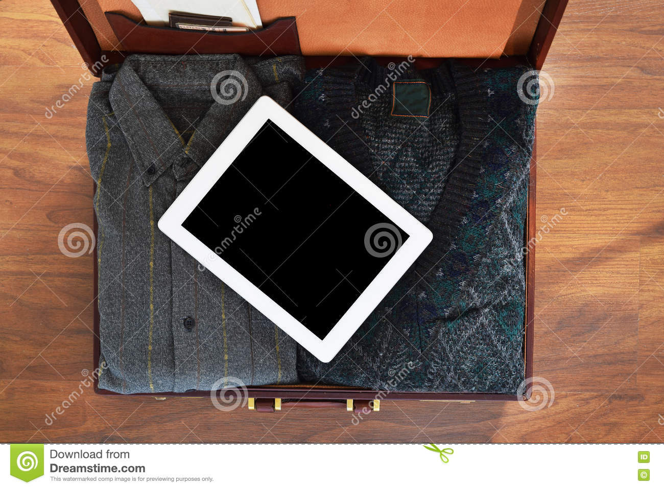 Top View Of Old Suitcase With Clothes On Wooden Floor  Stock