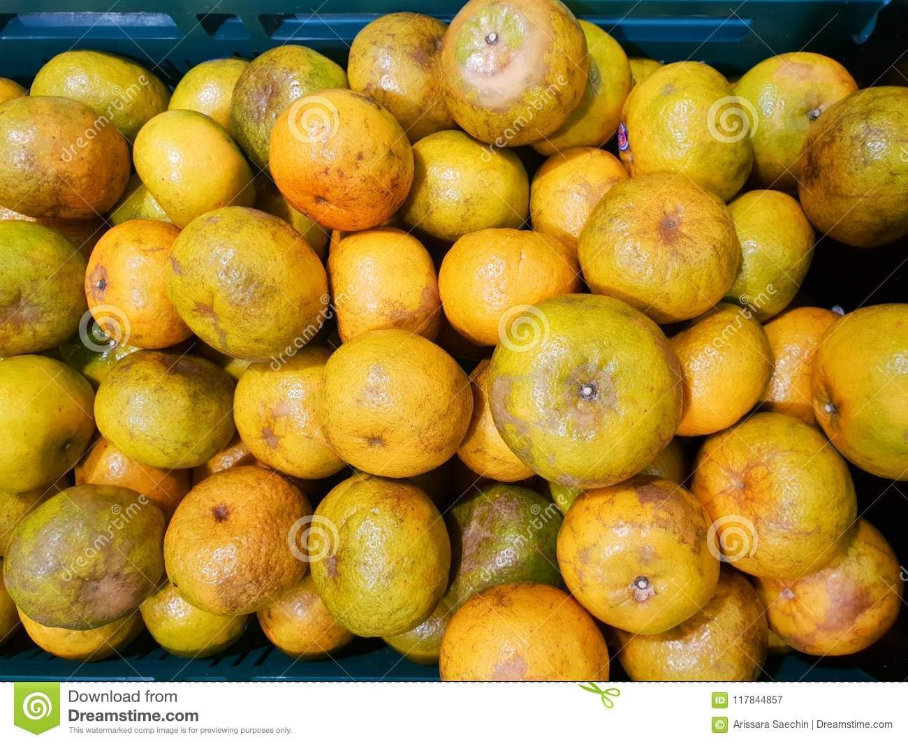 Top view of orange fruit as a background on market stand in Thailand.
