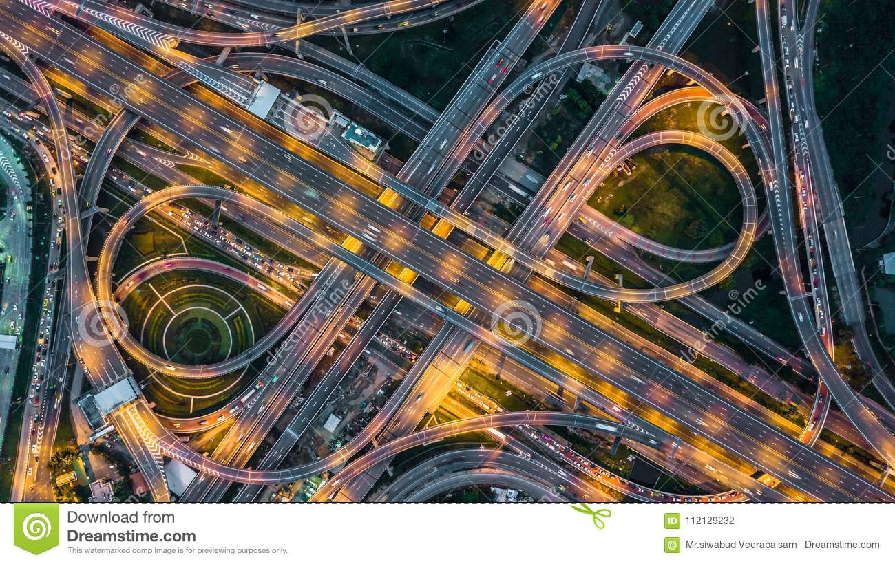 Top view over the highway,expressway and motorway at night, Aerial view interchange of a city, Shot from drone, Expressway is