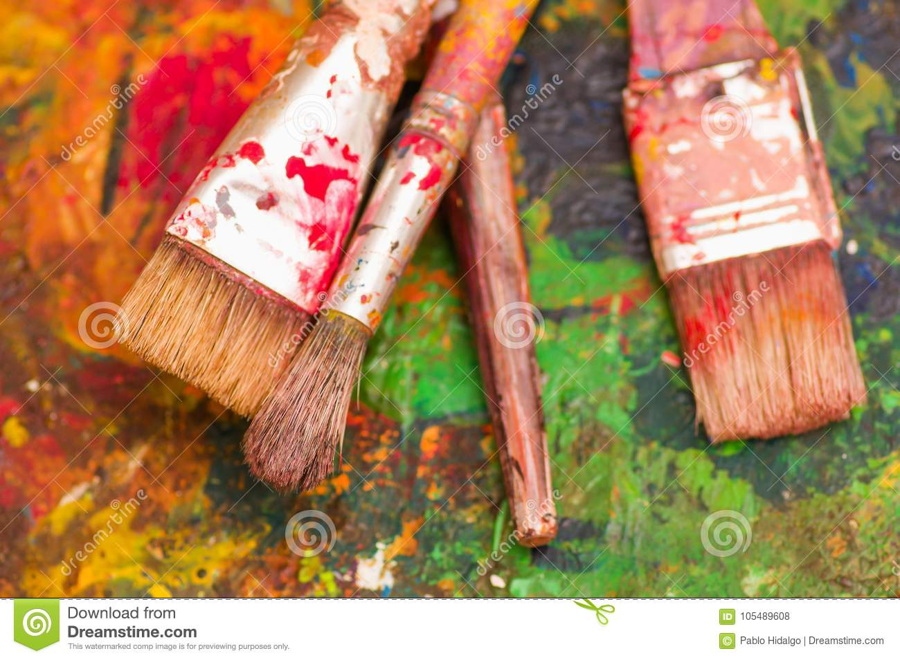 Top view of paint brushes over a color palette in a for Best all over paint color
