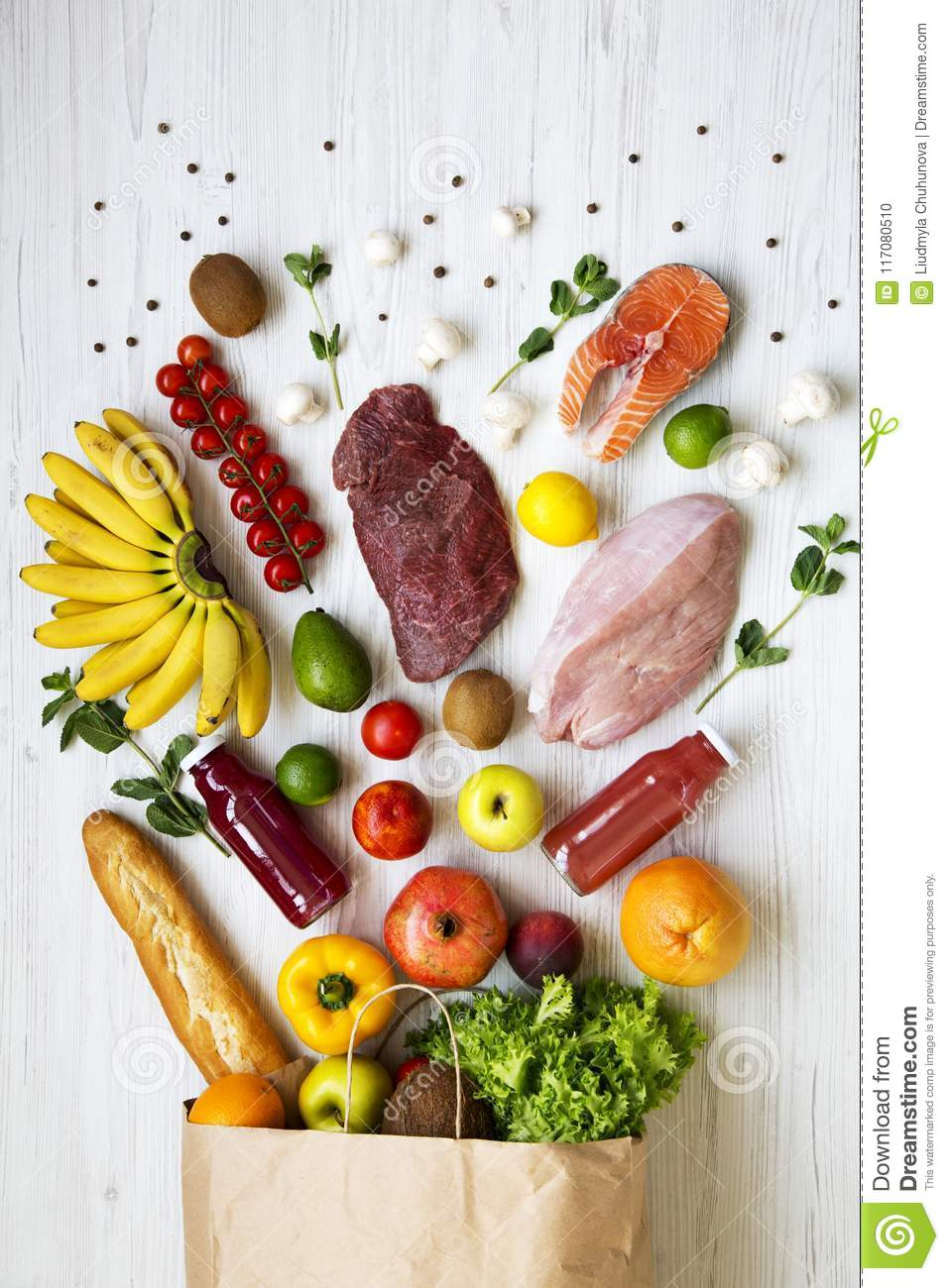Top view, paper bag of various health food. Healthy eating. White wooden background. From above,