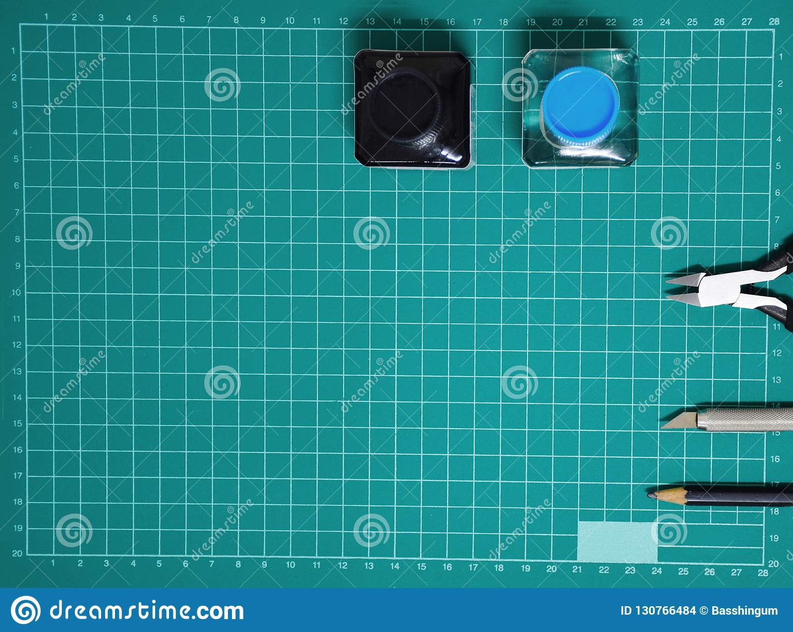 Top view Plastic model tool kit ink, art knife, cutting pliers on Cutting plate and copy space