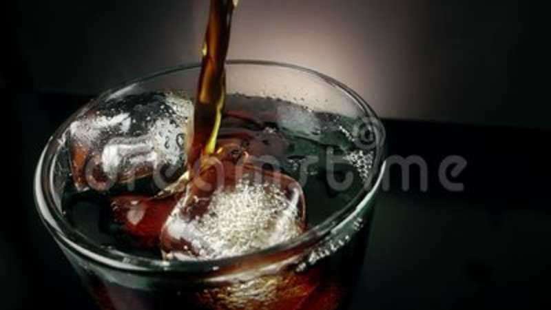 Top Of View Pouring Of Fresh Coke In The Drink Glass With Ice Cubes On Black Background Fun And Summer Time