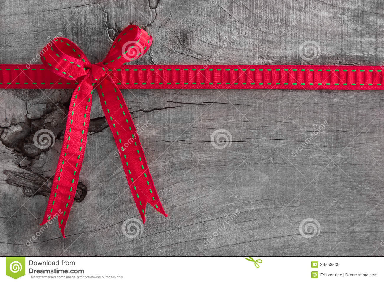 top view of ribbon decoration on wooden background for