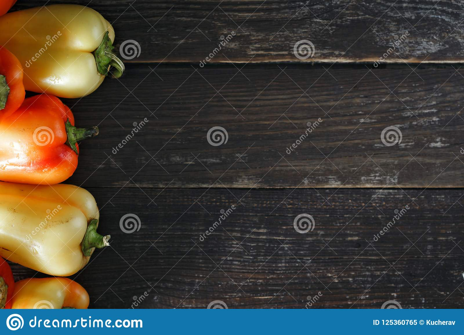Top view set red yellow homemade pepper dark background border