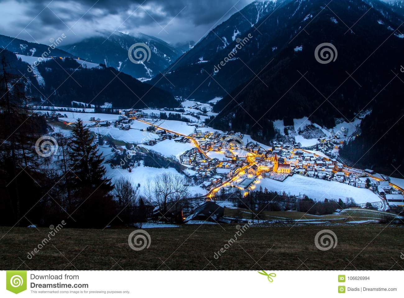 Top view on snowy village luesen valley at night south tirol It