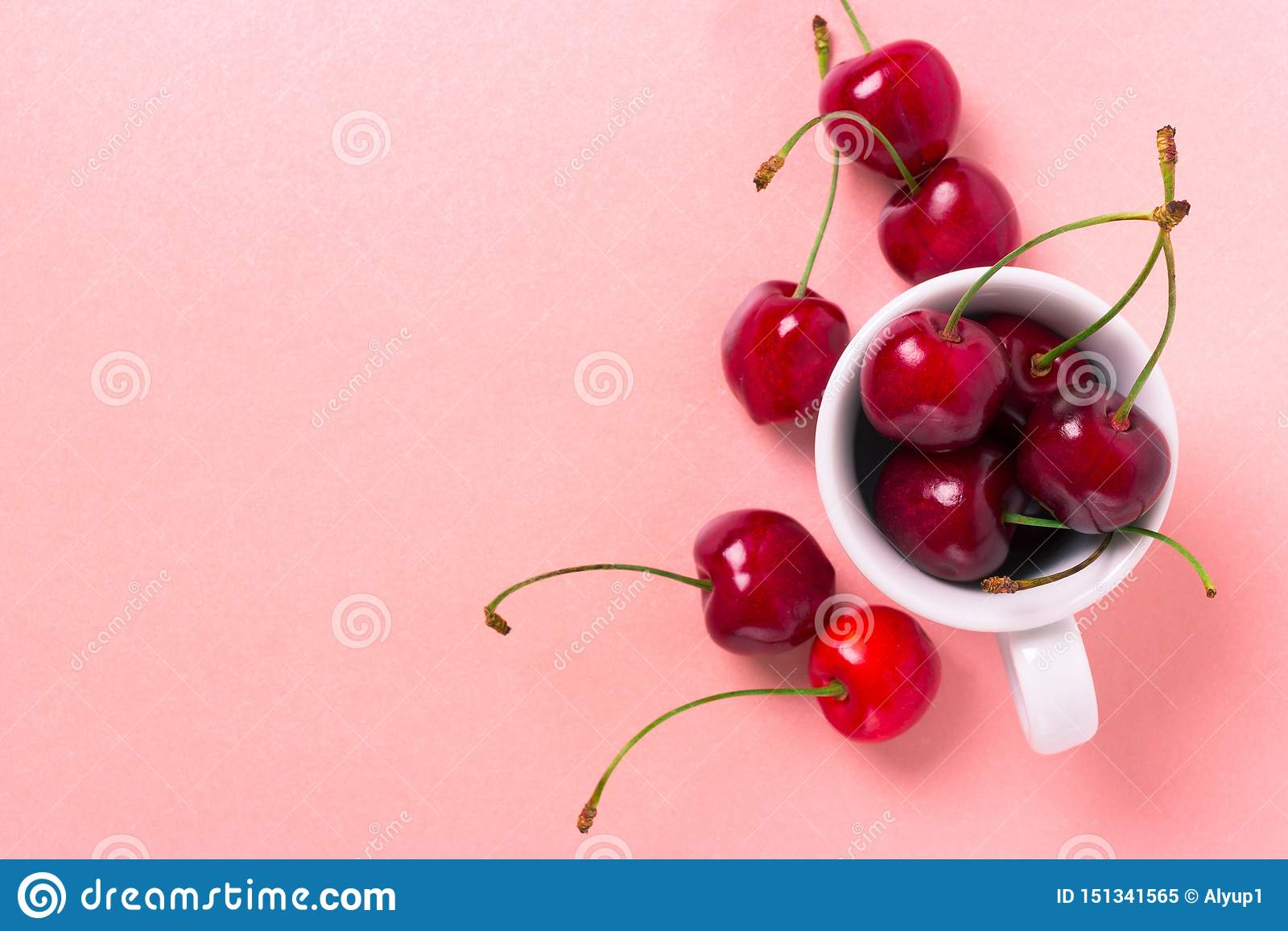 Sweet cherry in the white cup