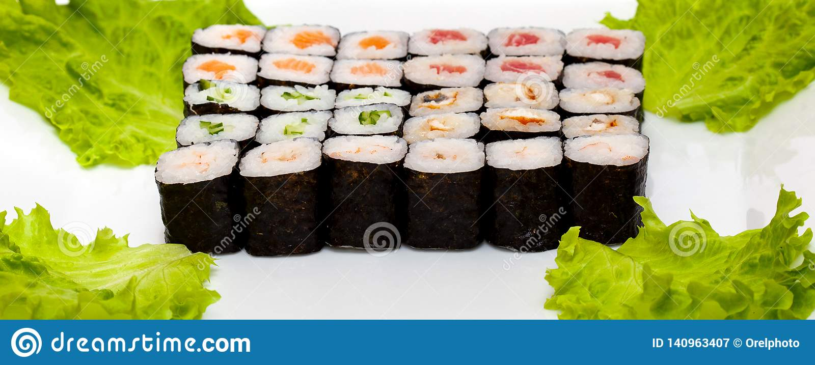 Top view on sushi set isolated over white background. Plate with rolls close-up