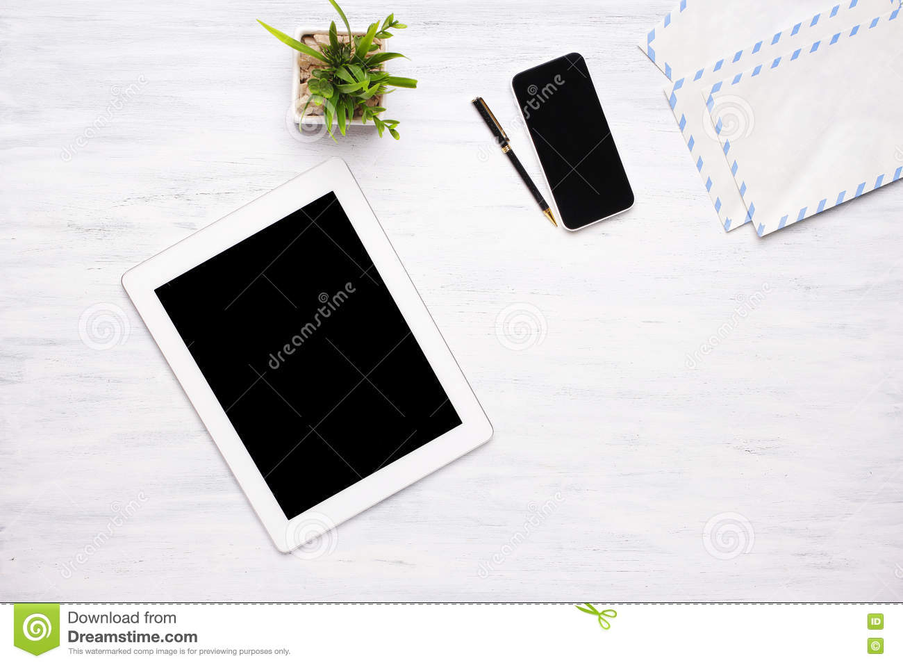 home office items. Download Top View Of Tablet Computer And Office Items On Wooden Table. Stock Image - Home