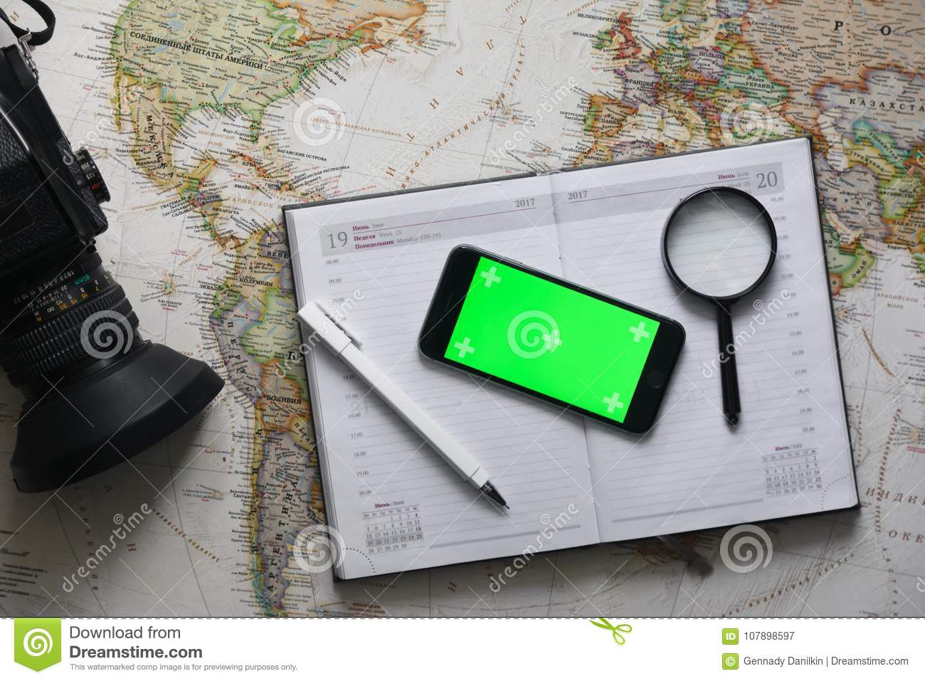 Top View  Smart Phone With Green Screen Lies On The Diary