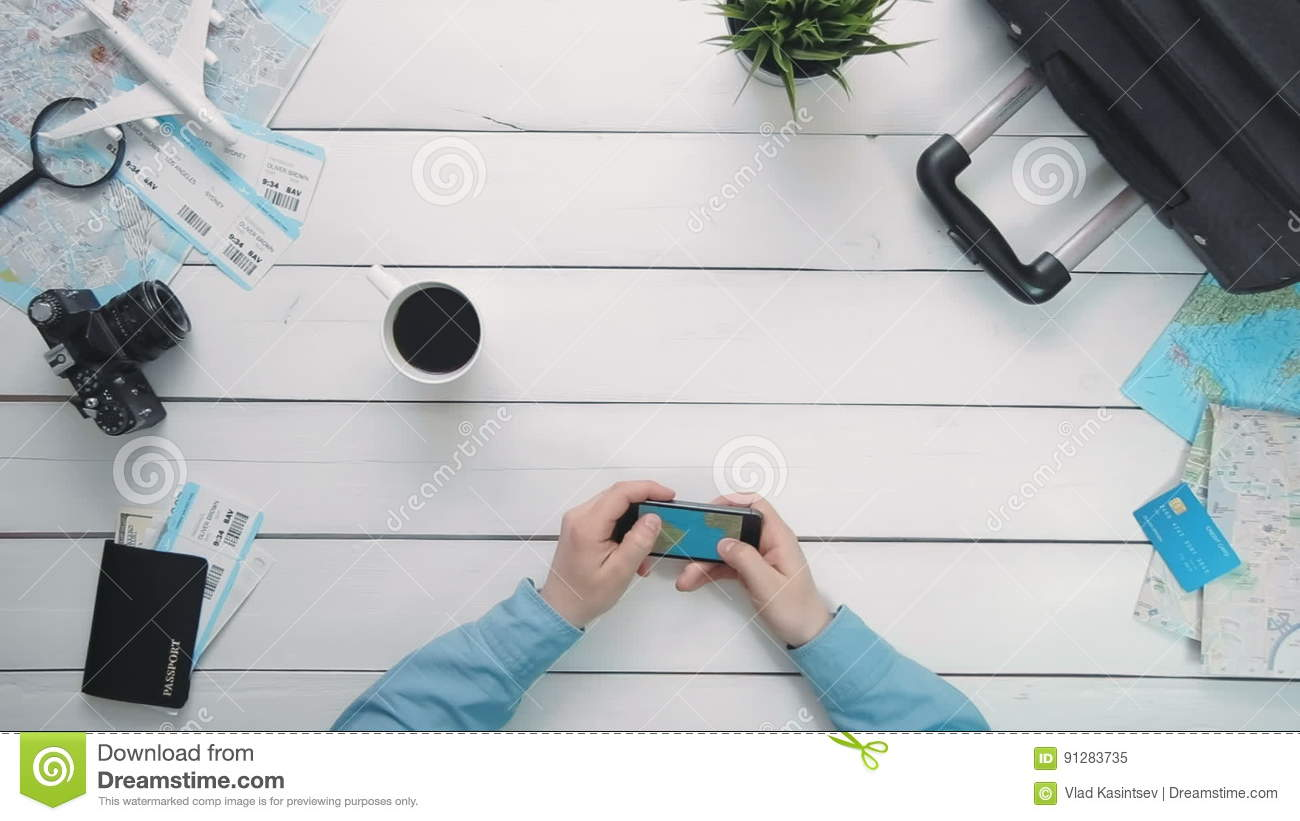Top view travelers hands looking at world map using smartphone at top view travelers hands looking at world map using smartphone at white wooden desk stock video video of plan hands 91283735 gumiabroncs Image collections