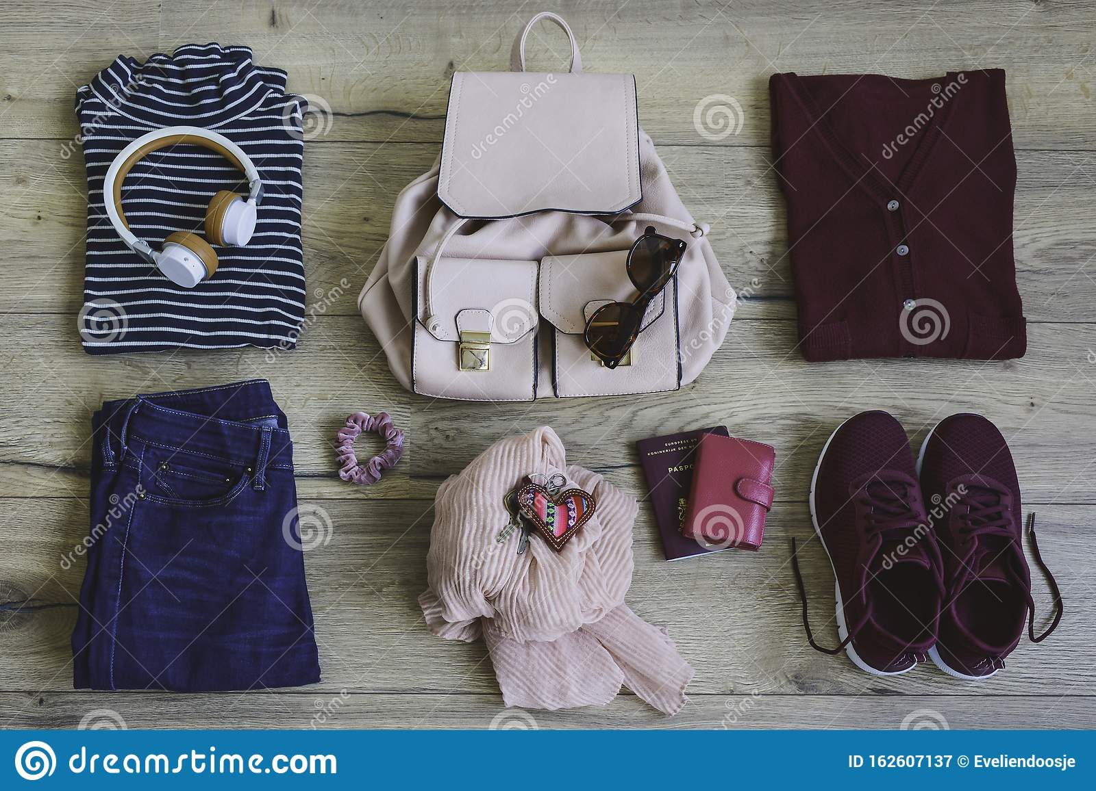 Top View Of Travelers Clothes And Accessories On Wooden Background Stock Image Image Of Concept Journey 162607137