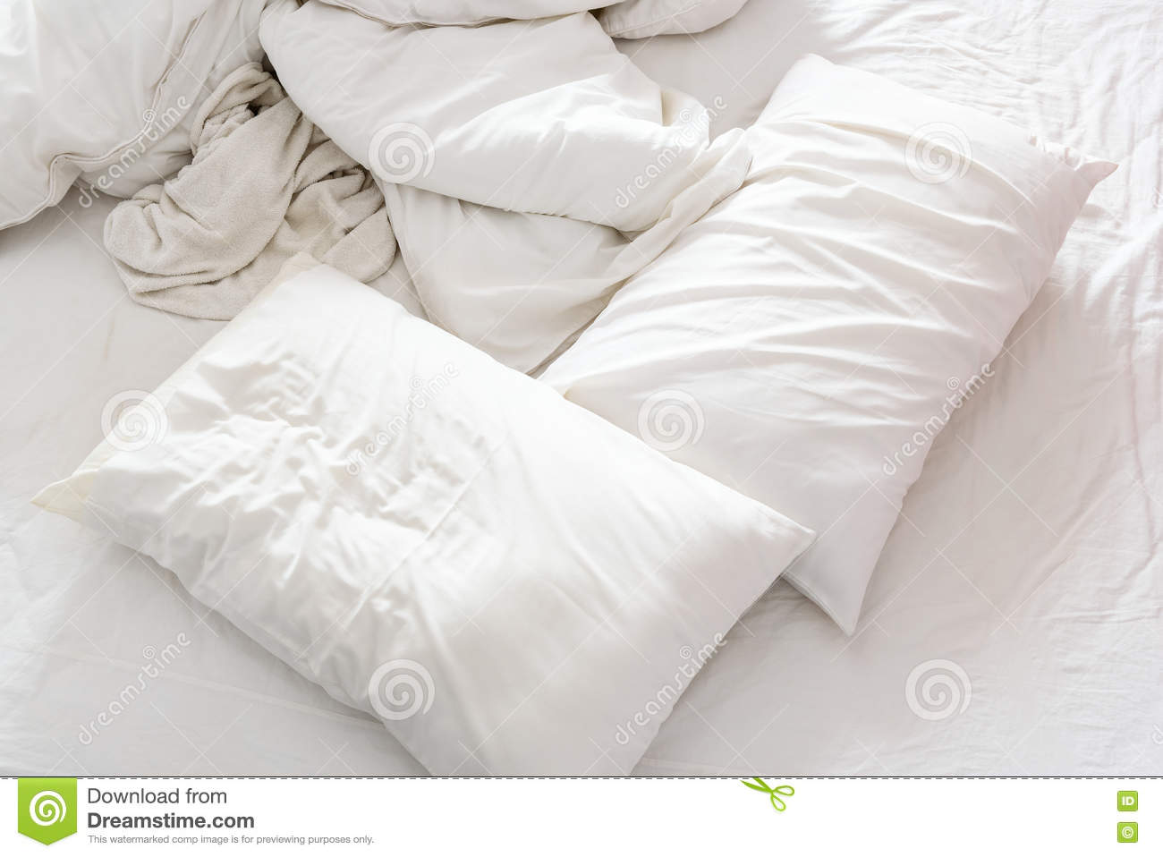 Rumpled bed sheet - Top View Of An Unmade Bed In A Bedroom With Crumpled Bed Sheet Royalty Free