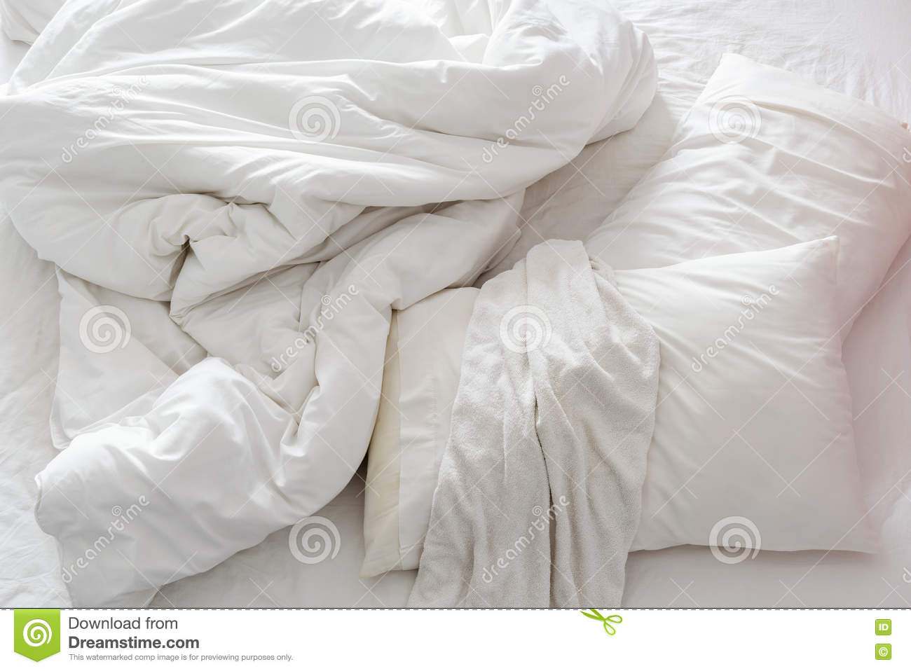 Rumpled bed sheet - Top View Of An Unmade Bed In A Bedroom With Crumpled Bed Sheet