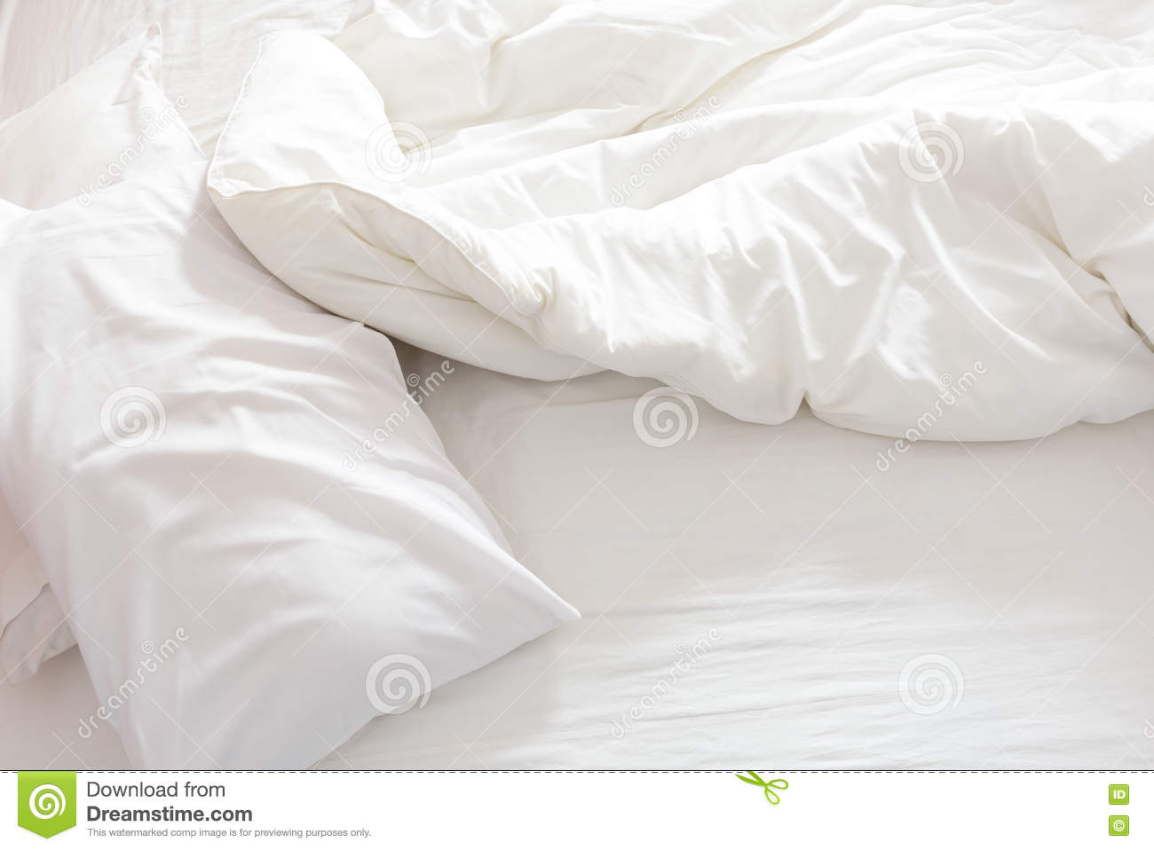 Rumpled bed sheet - Top View Of An Unmade Bed With Crumpled Bed Sheet