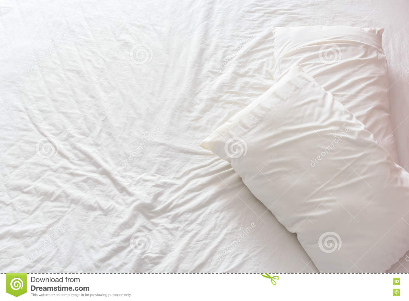 Rumpled bed sheet - Top View Of An Untidy Unmade Bed With White Crumpled Bed Sheet And Two Messy
