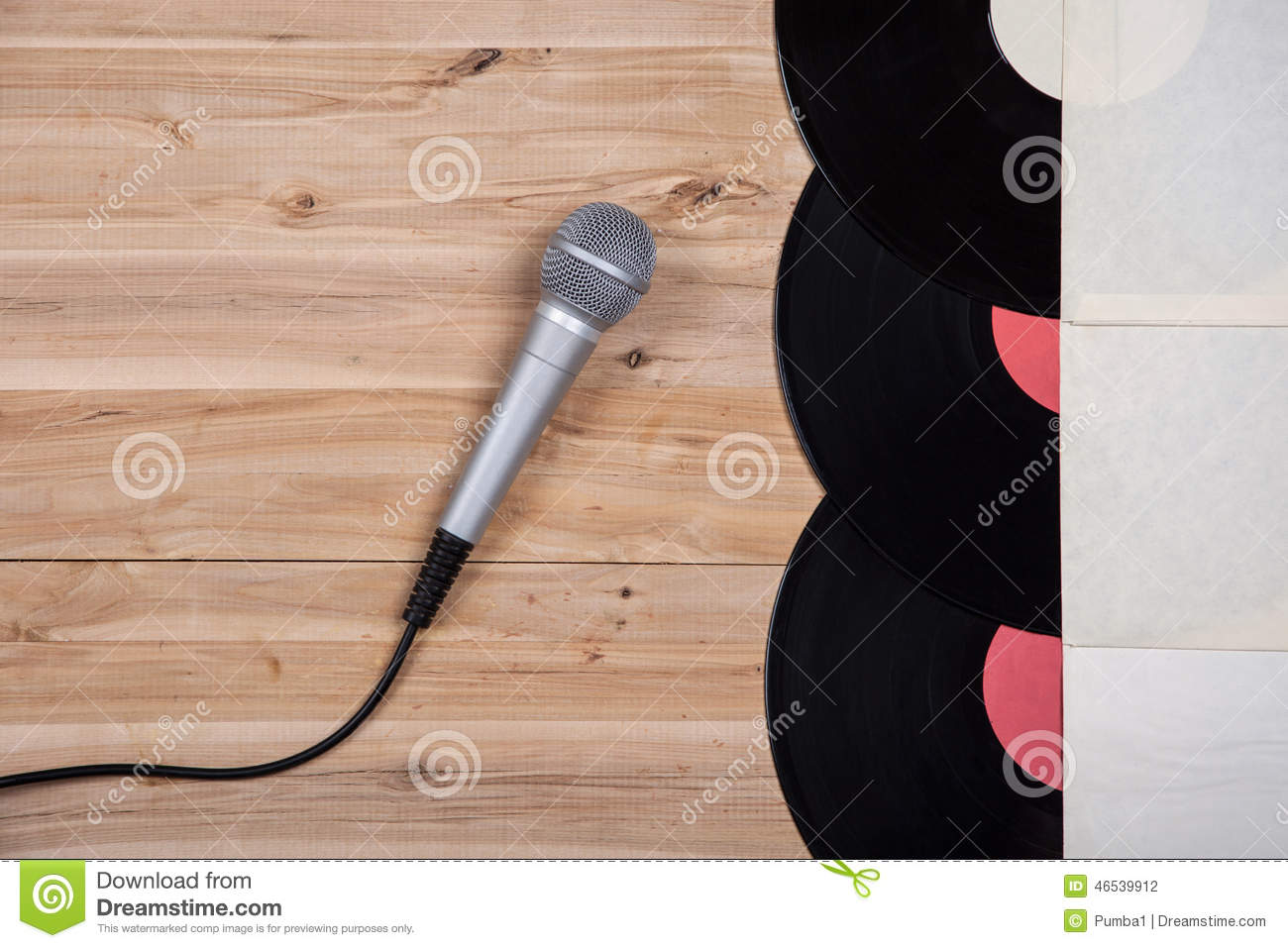 Top View Of Vinyl Record Over Wooden Table And Microphone