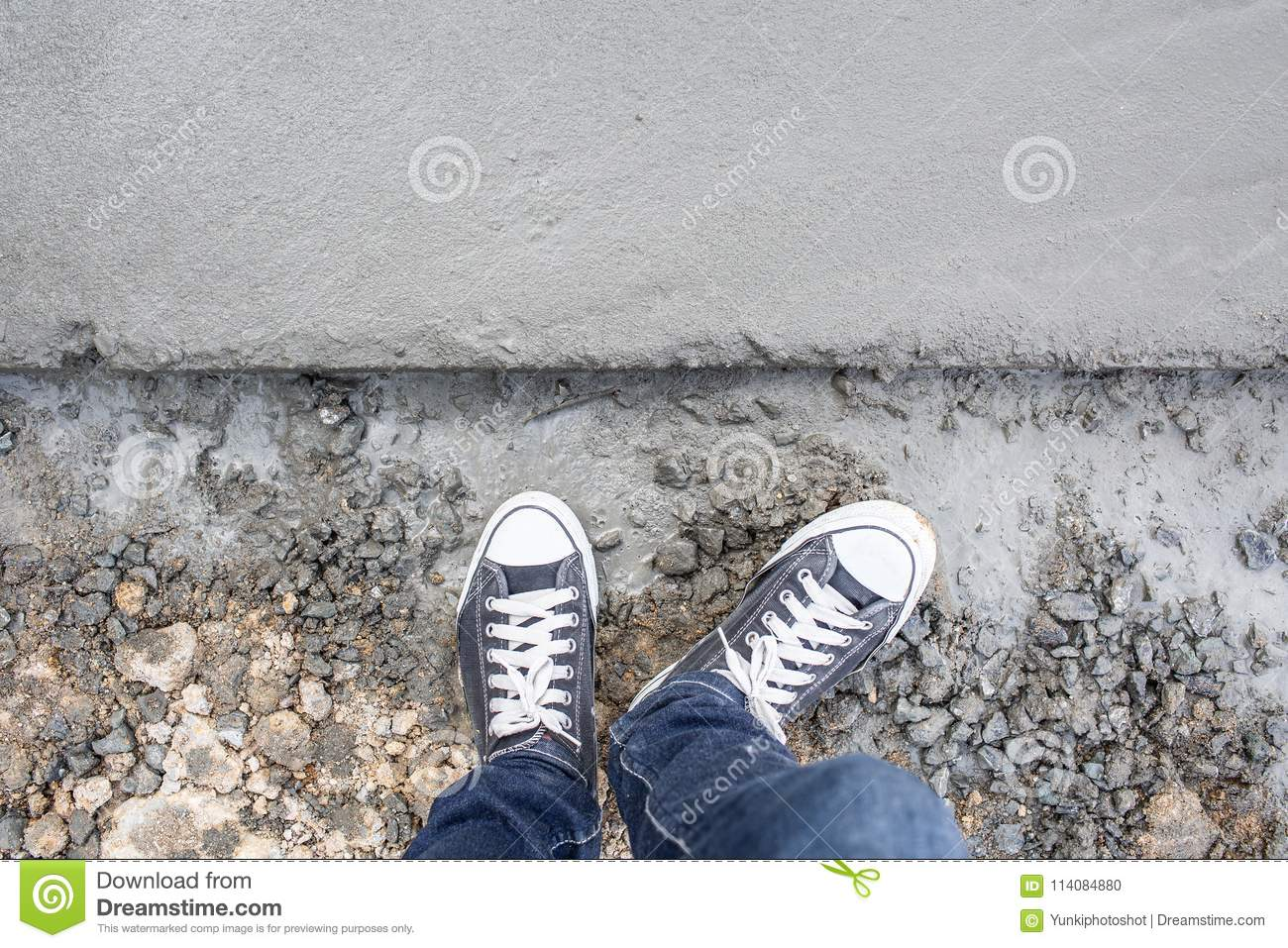 Top View Wet Concrete Cement Floor With Man Leg And Sneakers