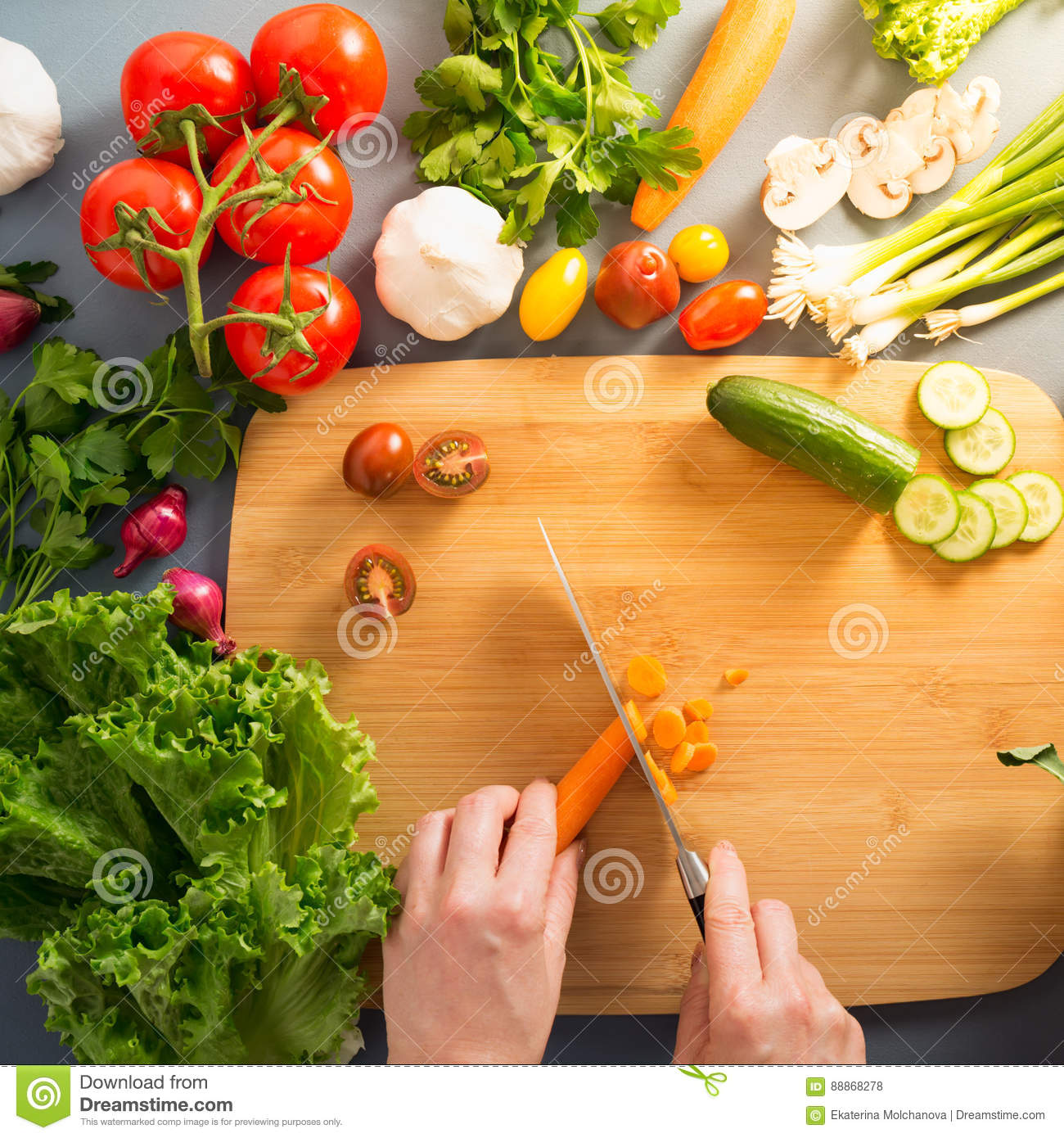 Top View Of Woman Cooking Healthy Food: Cutting Vegetable