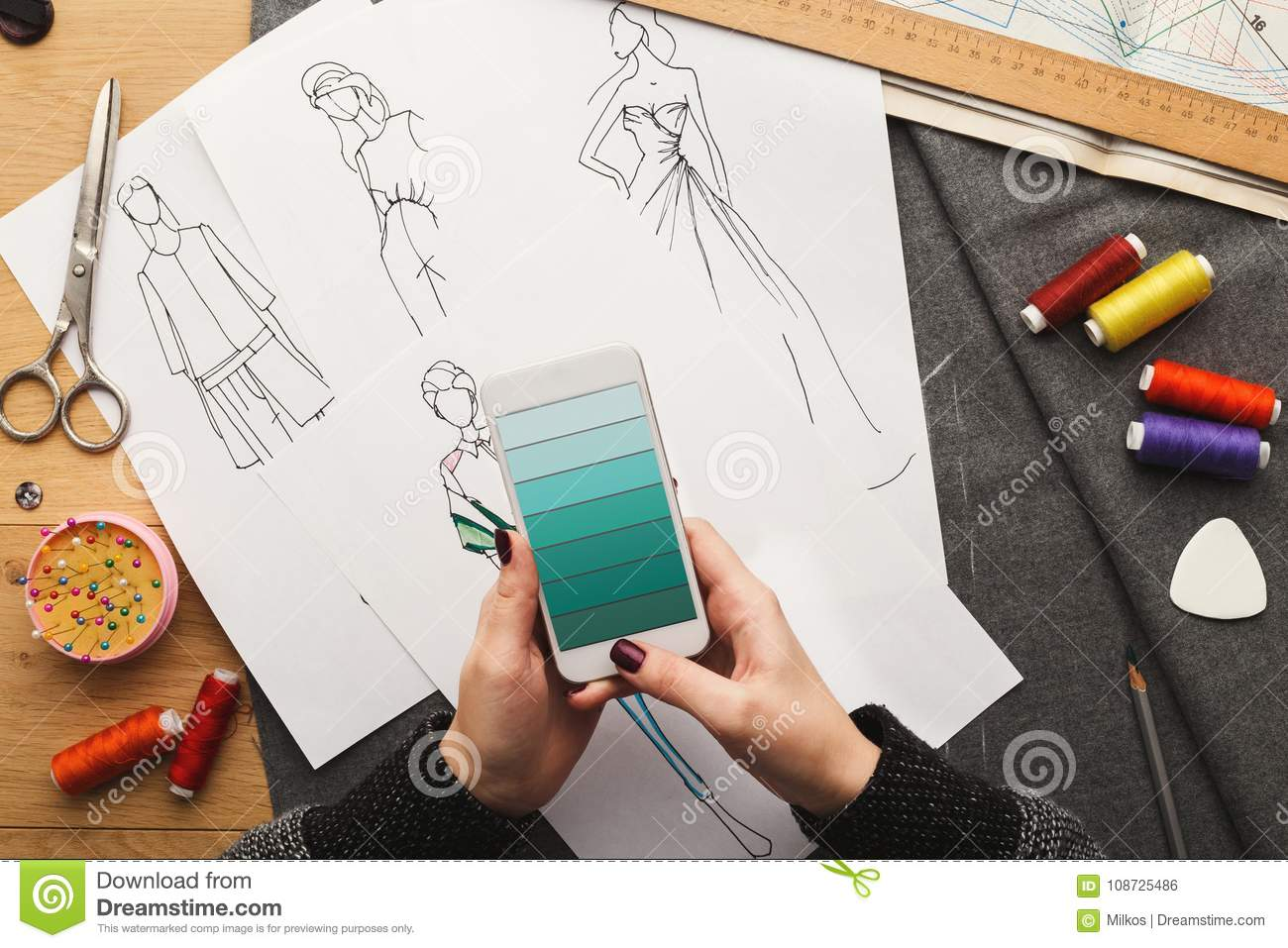 top view on woman designer drawing clothes sketches stock photo