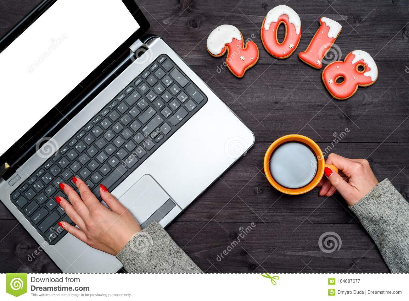 Top View Of Woman Hand Holding Cup Of Hot Coffee And Typing On Open