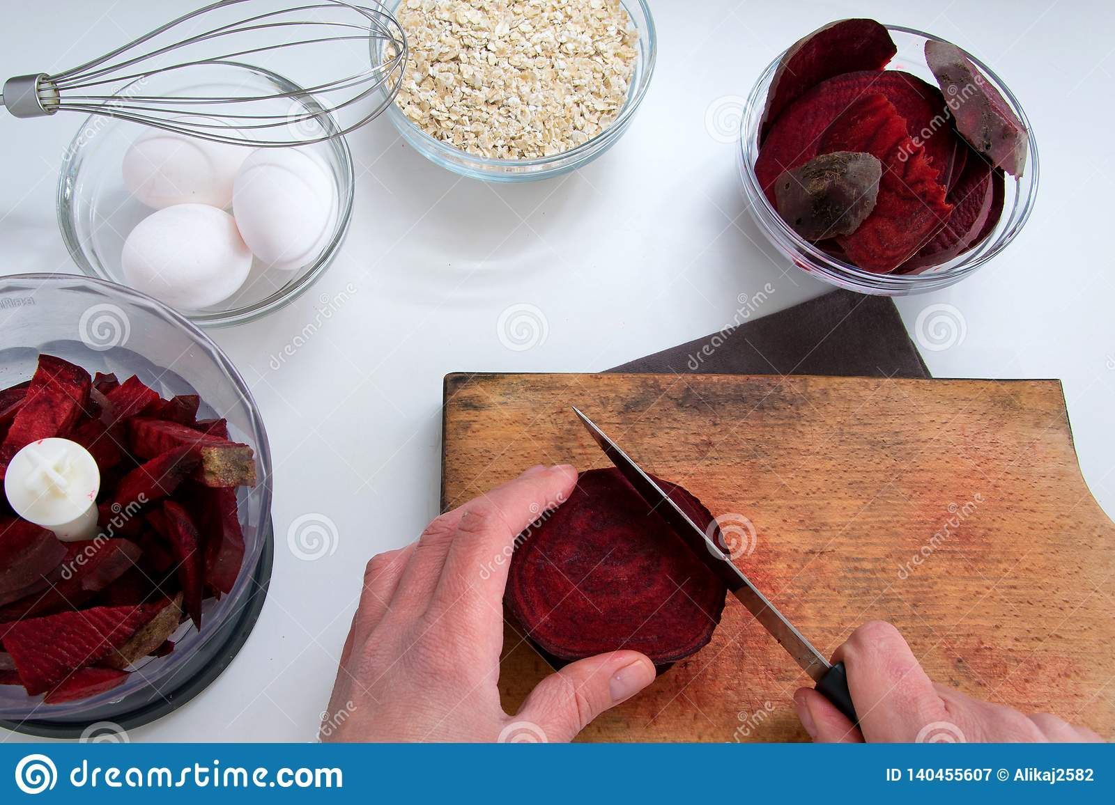 Top view of woman hands cooking healthy dessert with red beet roots, oats and eggs
