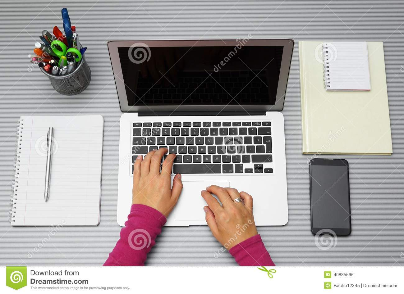 Top view of woman working with laptop in office or at home