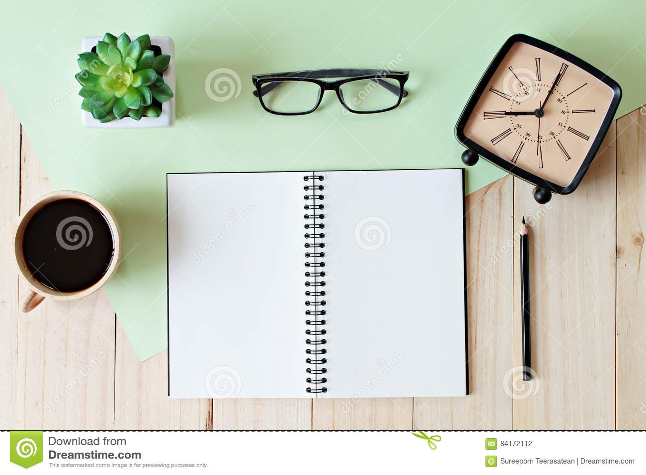 Top View Of Working Desk With Blank Notebook With Pencil, Coffee Cup, Eyeglasses, Retro Alarm ...
