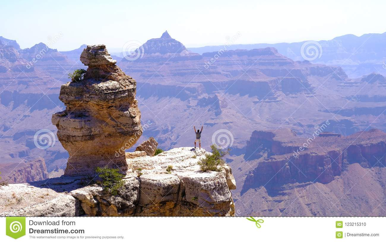 check out cac0a 3d3a5 Epic view in Moranpoint in front of `Duck on a rock` in The Grand Canyon  National Park South Rim Arizona USA. Persons hands in the air celebrating.