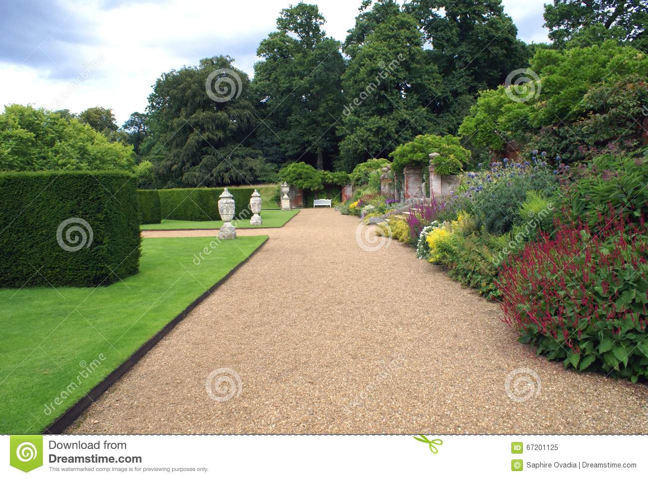 Topiary Garden Path With Ornaments, Bench, And Herbaceous ...