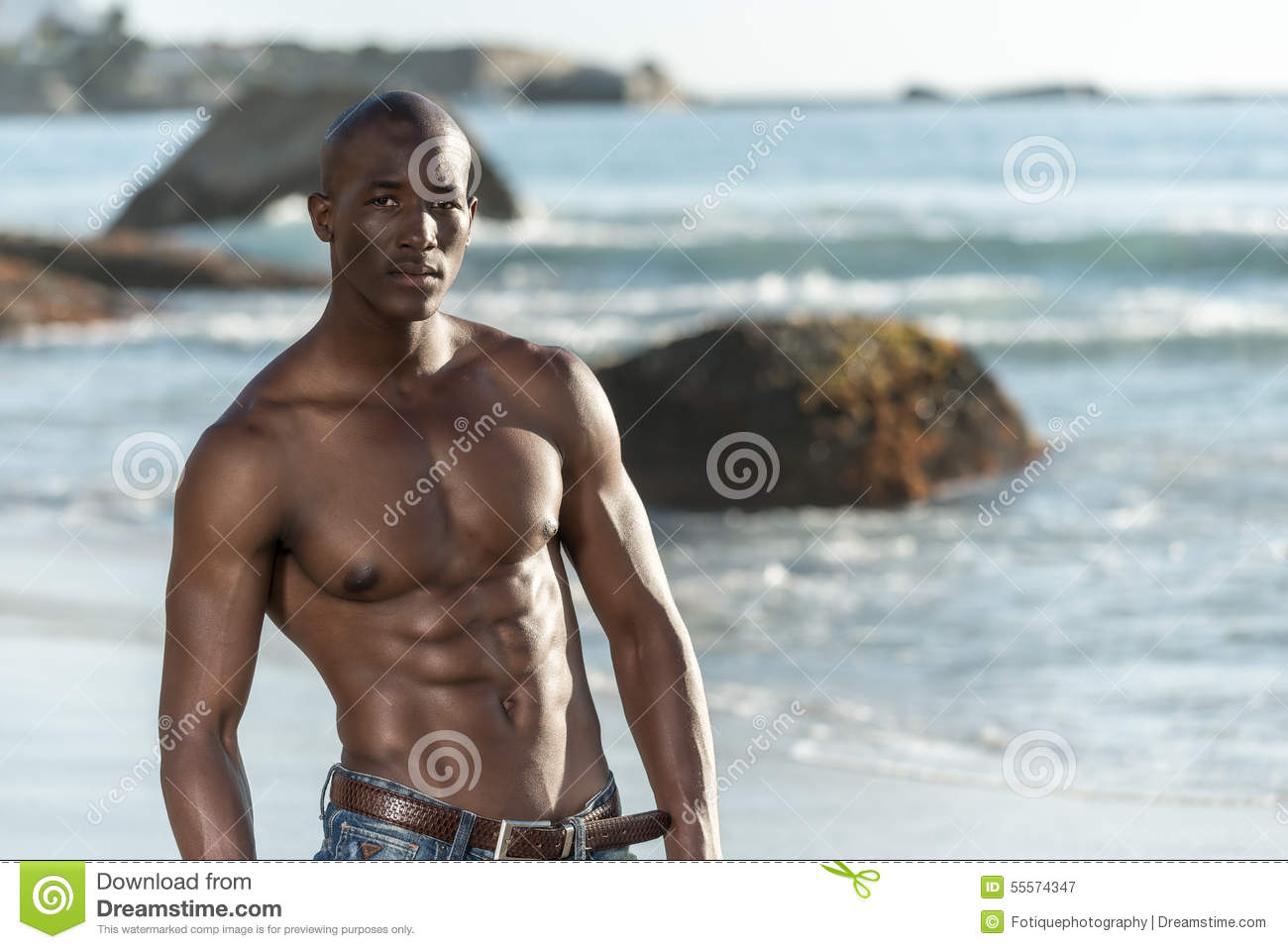 African Poren topless african black man on beach stock image - image of