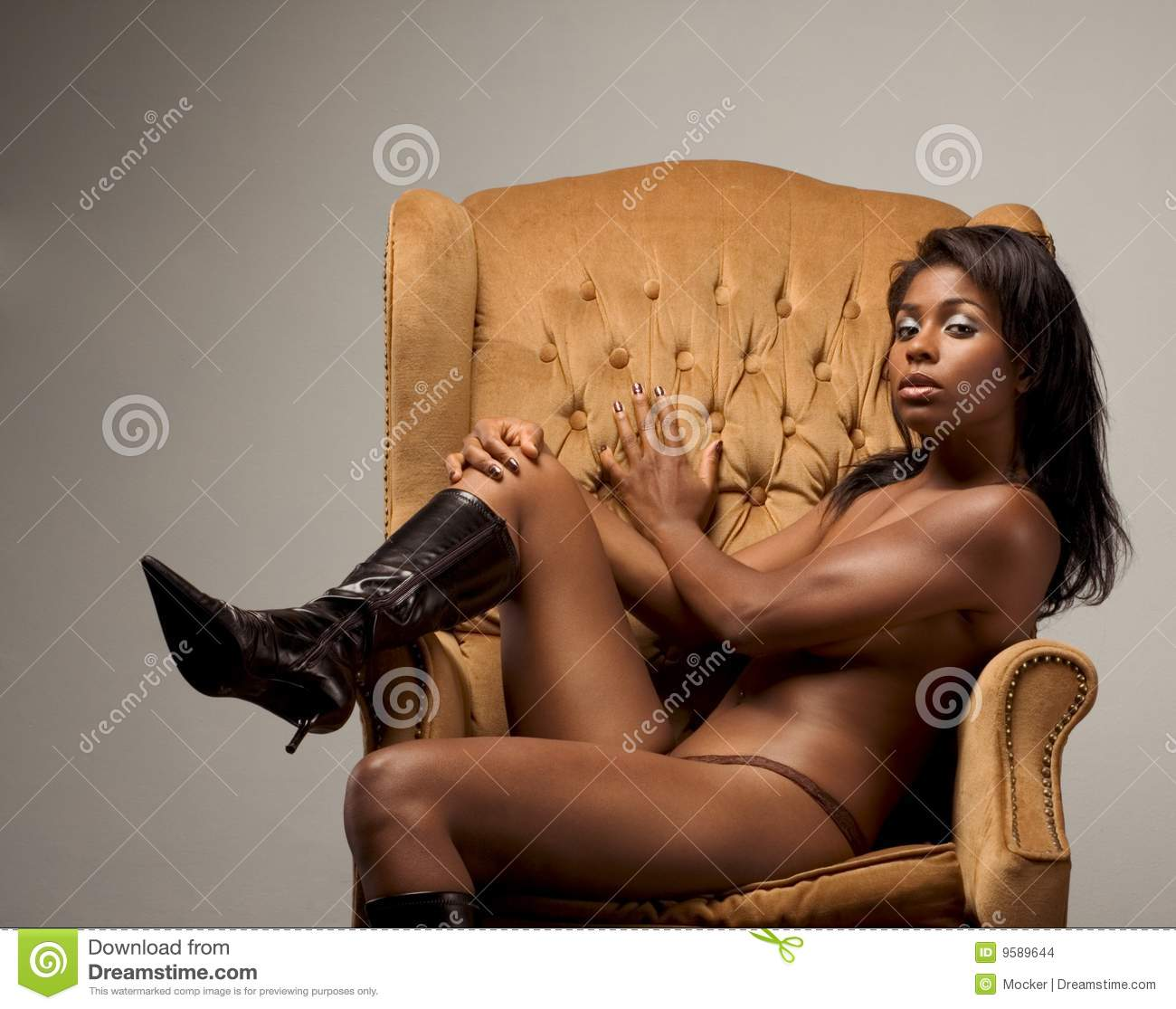 Naked women sitting on leather chairs