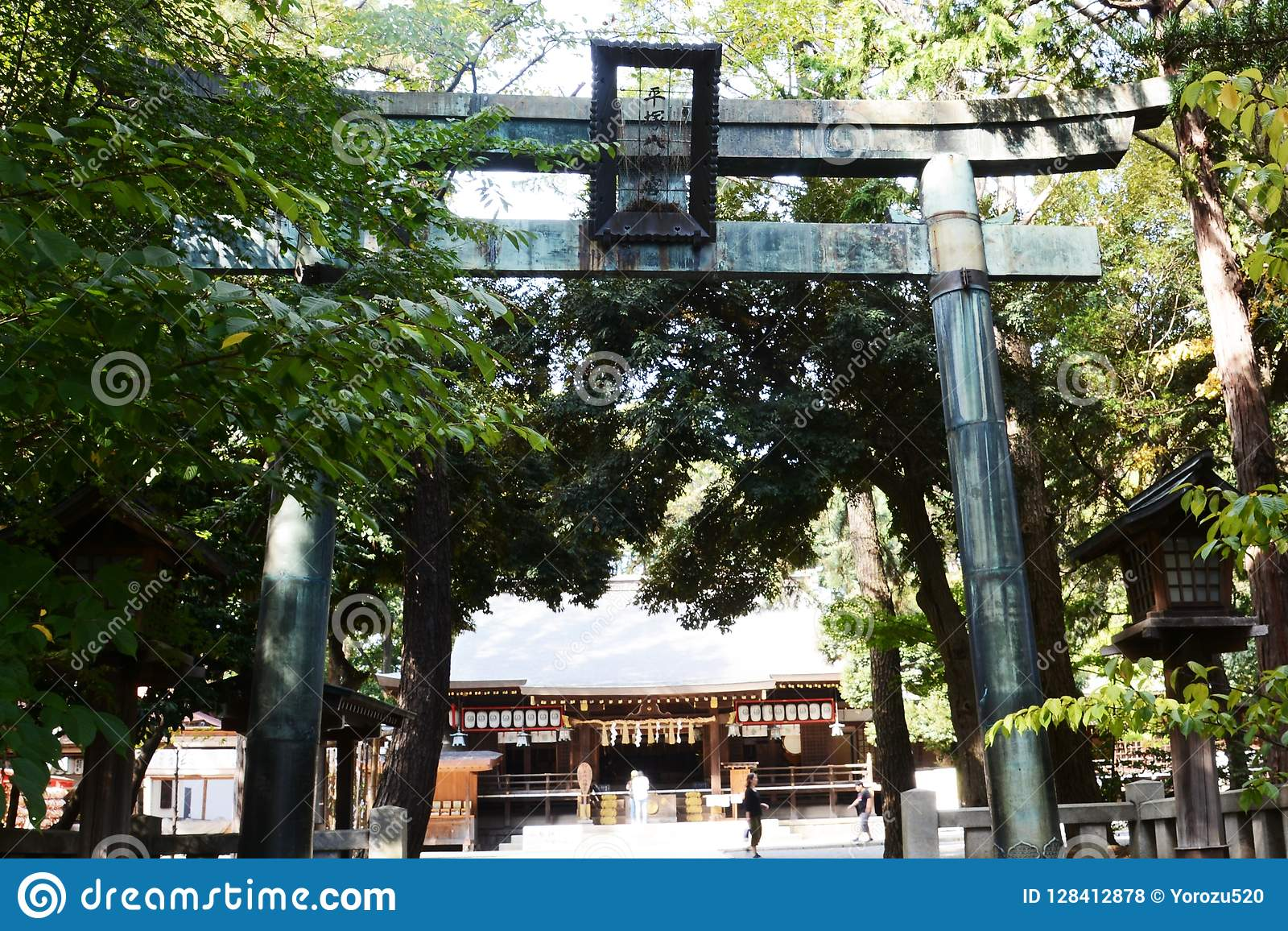 Torii gate and guardian dogs of Shinto shrine
