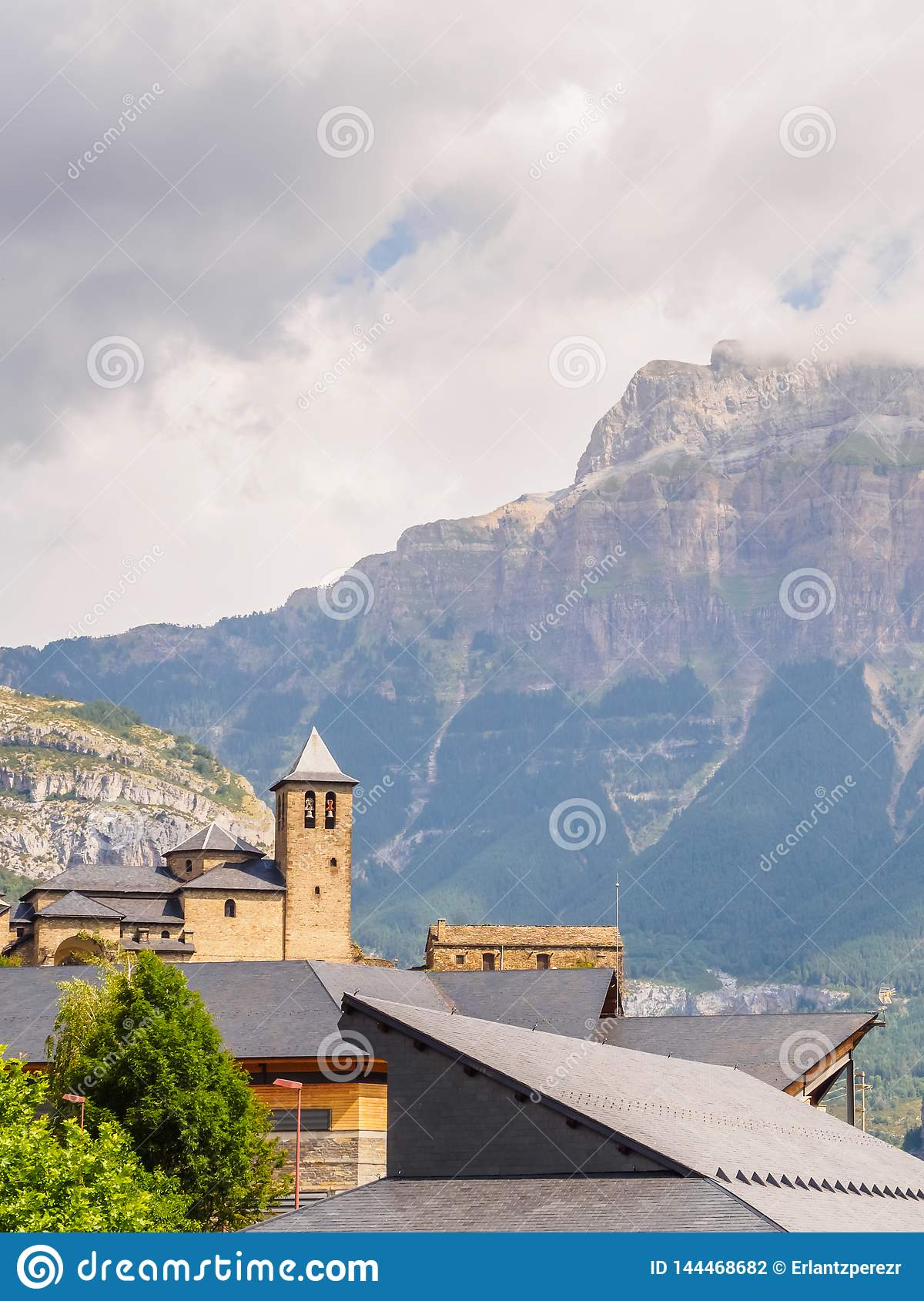 Torla Ordesa, church with the mountains at bottom, Pyrenees Spain vertical