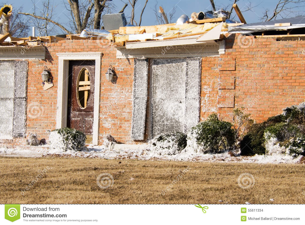Exterior House Insulation : Tornado destroyed brick house with insulation debris and