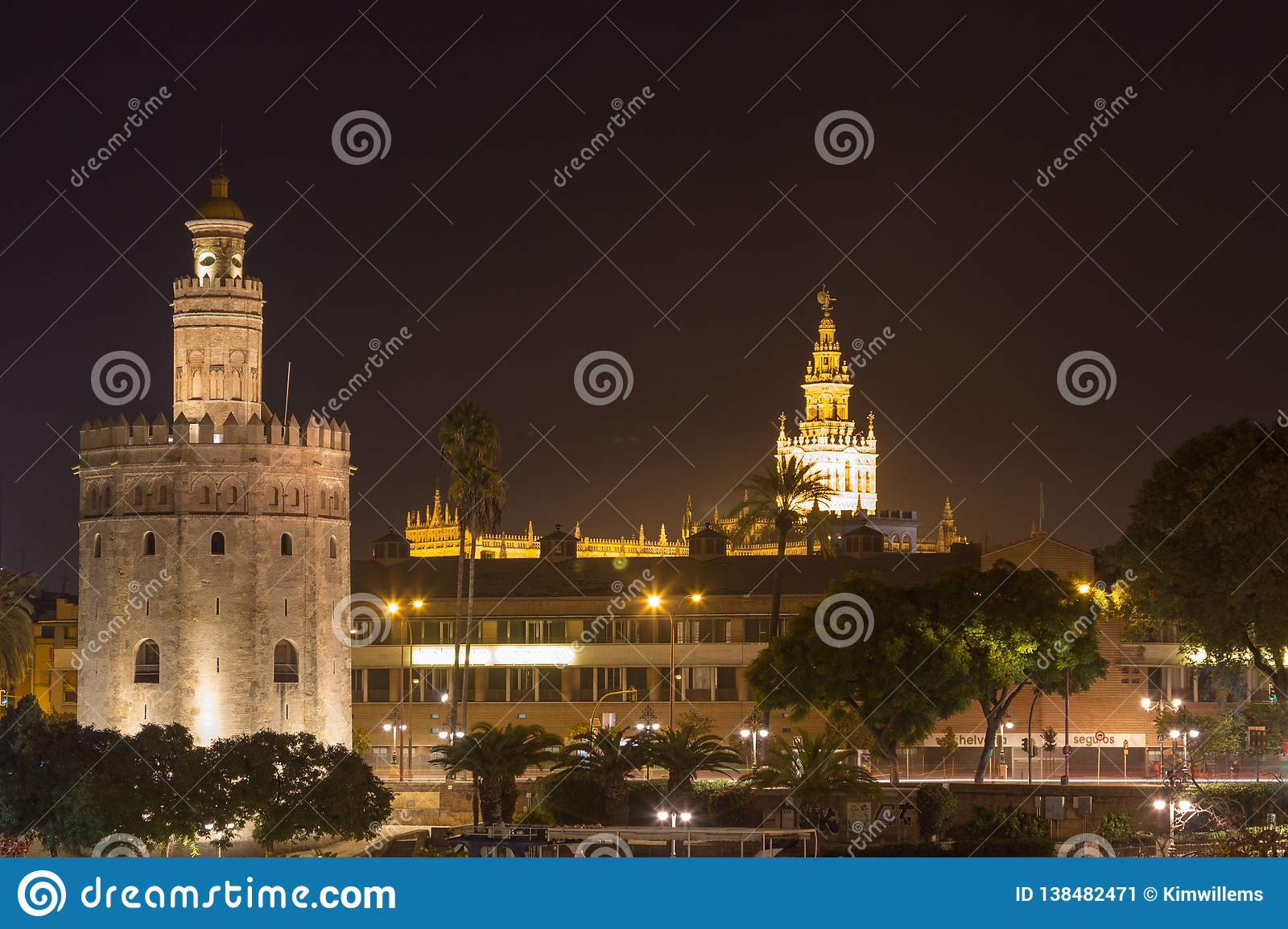 View on Torre del Oro and Giralda from calle Betis in Seville at night