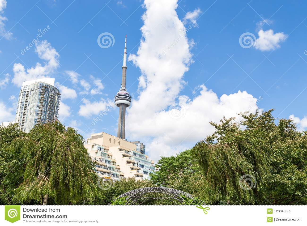 TORONTO, ON, CANADA - JUL 09, 2016: The top of the CN Tower and surrounding apartment buildings in downtown Toronto.